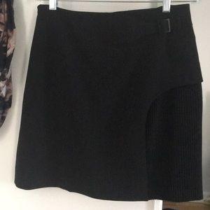 Cute skirt alert! Black buckle and pleat detail.